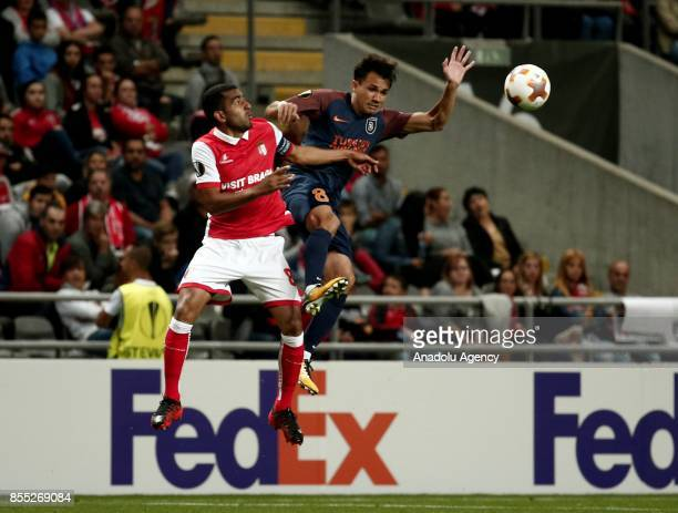 Marcio Mossoro of Medipol Basaksehir in action against Marcelo Goiano of Sporting Braga during the UEFA Europa League Group C match between Sporting...