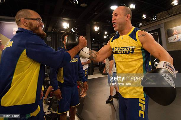Marcio 'Pedra' Santos greets Wanderlei Silva before a Team Werdum training session during filming of season two of The Ultimate Fighter Brazil on...