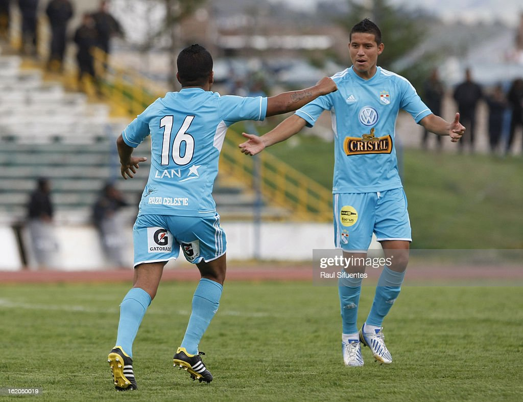 Marcio Valverde of Sporting Cristal celebrates a goal with Marcos Delgado during a match between Sport Huancayo and Sporting Cristal as part of The Torneo Descentralizado 2013 at the Huancayo Stadium on February 18, 2013 in Huancayo, Peru