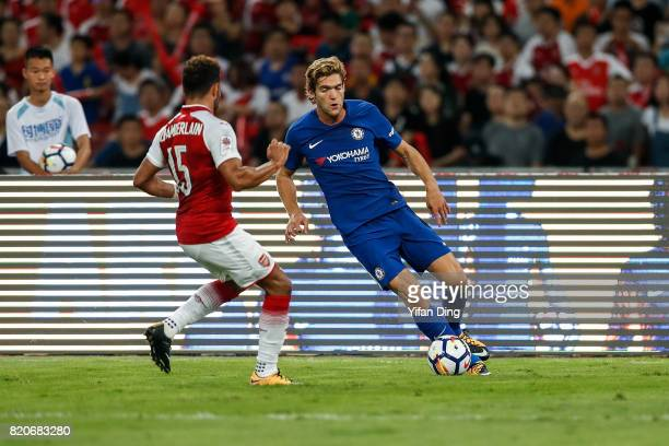Marco Alonso of Chelsea dribbles against Oxlade Chamberlain of Arsenal during the PreSeason Friendly match between Arsenal FC and Chelsea FC at Birds...
