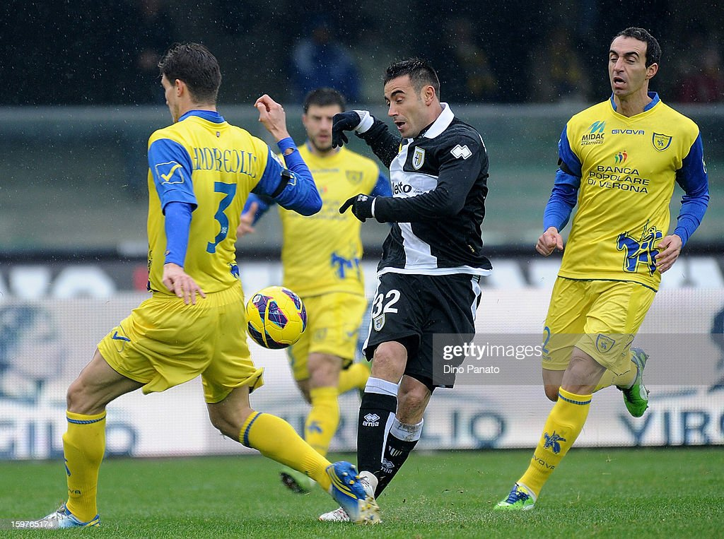 Marco Amndreolli (L) of Chievo Verona competes with Nicola Sansone of Parma FC during the Serie A match between AC Chievo Verona and Parma FC at Stadio Marc'Antonio Bentegodi on January 20, 2013 in Verona, Italy.