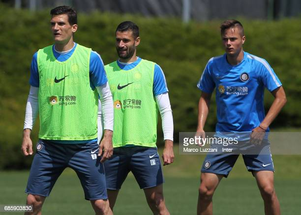 Marco Andreolli Antonio Candreva and Zinho Vanheusden look on during the FC Internazionale training session at the club's training ground 'La...