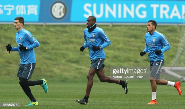 Marco Andreolli Geoffrey Kondogbia and Jeison Murillo run during the FC Internazionale training session at the club's training ground Suning Training...