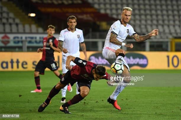 Marco Andreolli of Cagliari Calcio clashes with Aljaz Struna of US Citta di Palermo during the TIM Cup match between Cagliari Calcio and US Citta di...