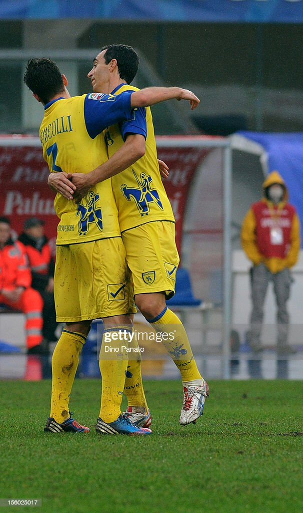 <a gi-track='captionPersonalityLinkClicked' href=/galleries/search?phrase=Marco+Andreolli&family=editorial&specificpeople=1452712 ng-click='$event.stopPropagation()'>Marco Andreolli</a> (L) of Chievo celebrates scoring the opening goal during the Serie A match between AC Chievo Verona and Udinese Calcio at Stadio Marc'Antonio Bentegodi on November 11, 2012 in Verona, Italy.