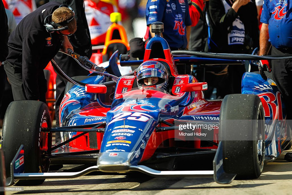 <a gi-track='captionPersonalityLinkClicked' href=/galleries/search?phrase=Marco+Andretti&family=editorial&specificpeople=540446 ng-click='$event.stopPropagation()'>Marco Andretti</a> driver of the #25 Andretti Autosport Dallara Chevrolet waits for fuel during Indianapolis 500 practice at the Indianapolis Motor Speedway on May 12, 2013 in Indianapolis, Indiana.
