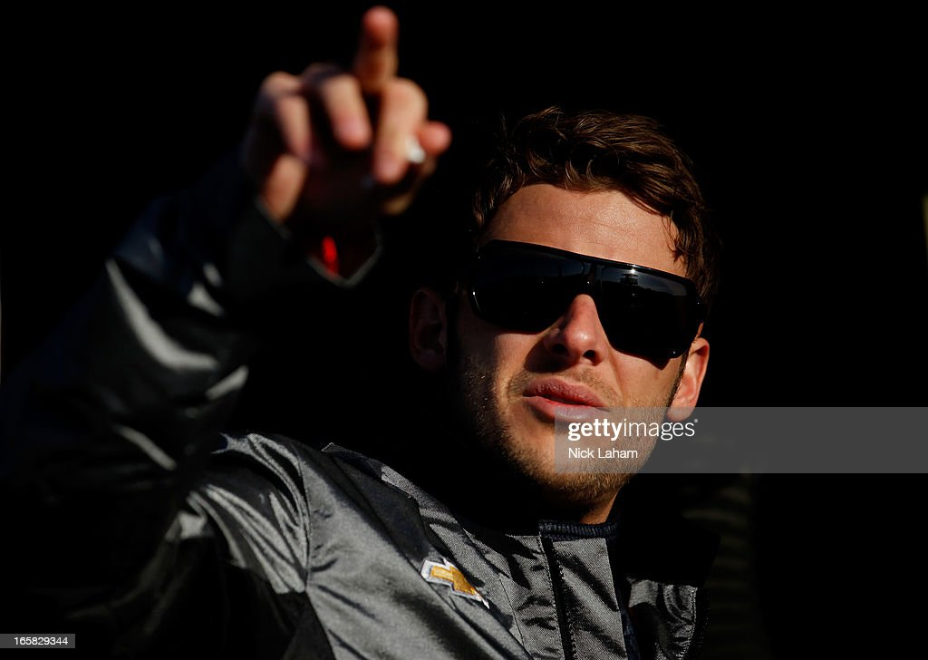 Marco Andretti, driver of the #25 Andretti Autosport RC Cola Chevrolet talks in his pit box during practice for the Honda Indy Grand Prix of Alabama at Barber Motorsports Park on April 6, 2013 in Birmingham, Alabama.