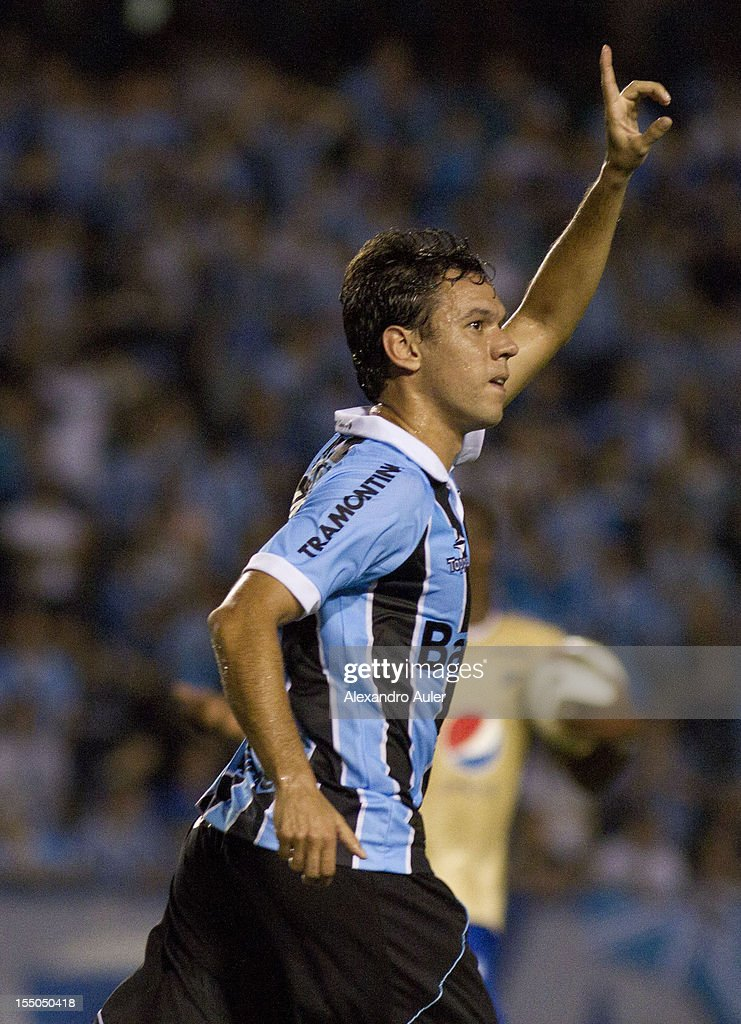 Marco Antonio of Gremio celebrates a goal during the match between Gremio (Brazil) and Millonarios (Colombia) as part of the eighth stage of Copa Sudamericana 2012 at Olímpico stadium on October 30, 2012 in Porto Alegre, Brazil. (Photo by Alexandro Auler/LatinContent/Getty Images).