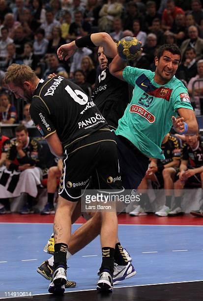 Marco Antonio Oneto Zuniga of Barcelona is challenged by Grzegorz Tkaczyk and Bjarte Myrhol of Rhein NEckar during the EHF Final Four semi final...