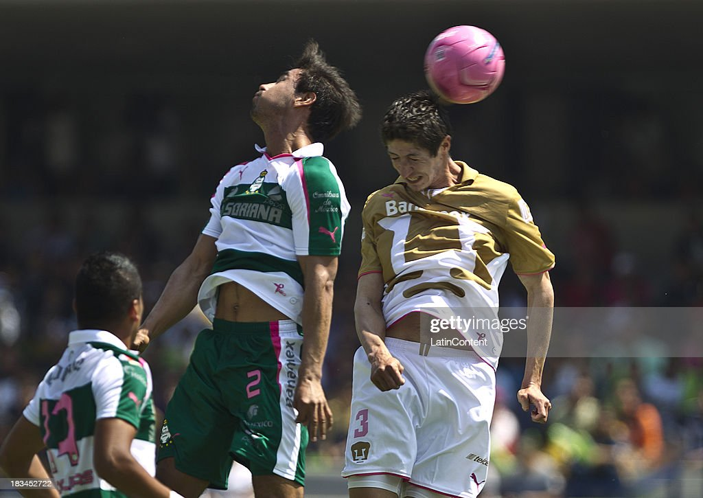 Marco Antonio Palacios of Pumas fights for the ball with <a gi-track='captionPersonalityLinkClicked' href=/galleries/search?phrase=Oswaldo+Alanis&family=editorial&specificpeople=6871353 ng-click='$event.stopPropagation()'>Oswaldo Alanis</a> of Santos during a match between Pumas and Santos as part of the Apertura 2013 Liga MX at Olympic Stadium on October 06, 2013 in Mexico City, Mexico.