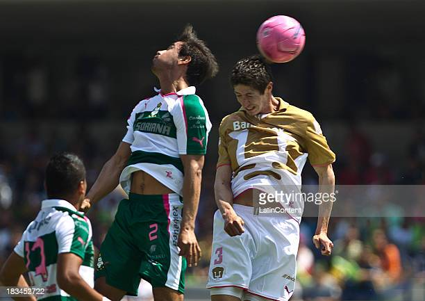 Marco Antonio Palacios of Pumas fights for the ball with Oswaldo Alanis of Santos during a match between Pumas and Santos as part of the Apertura...