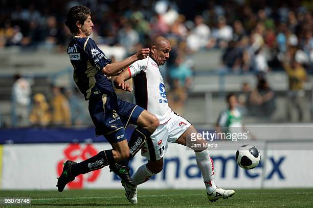 Marco Antonio Palacios of Pumas UNAM vies for the ball with Hector Jimenez of Indios during a Mexican league Apertura 2009 soccer match at the...
