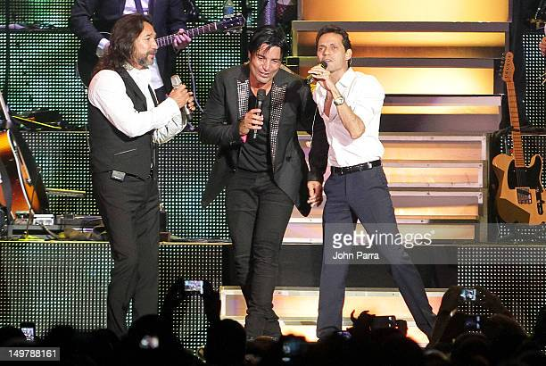 Marco Antonio Solis Chayanne and Marc Anthony perform during the tour opener at AmericanAirlines Arena on August 3 2012 in Miami Florida