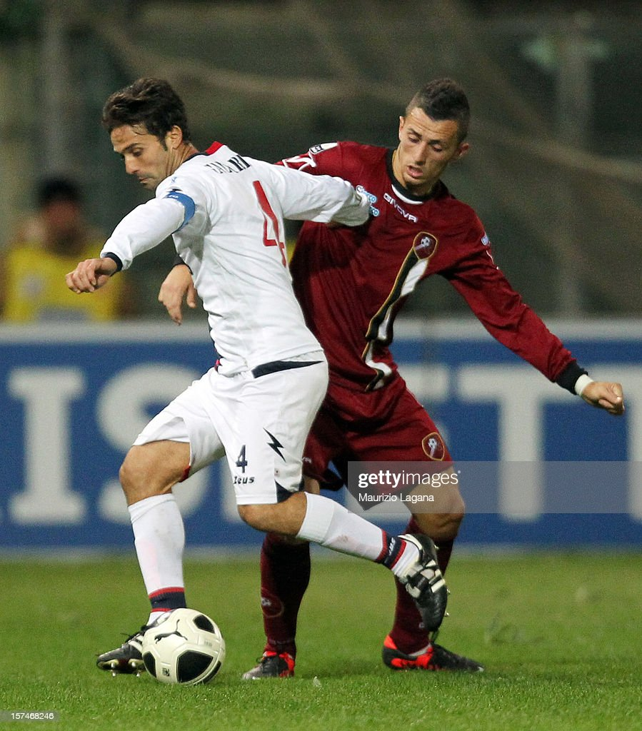 Marco Armellino of Reggina competes for the ball with Antonio Galardo of Crotone during the Serie B match between Reggina Calcio and FC Crotone at Stadio Oreste Granillo on December 3, 2012 in Reggio Calabria, Italy.