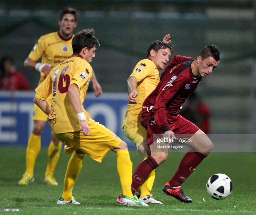 Marco Armellino of Reggina competes for the ball with Eros Schiavon and Daniele Baselli of Cittadella during the Serie B match between Reggina Calcio...