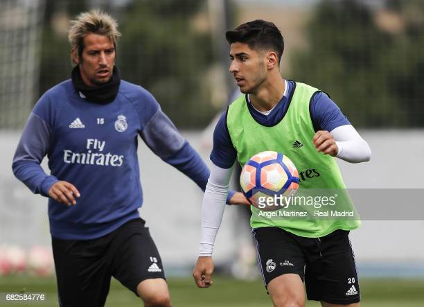 Marco Asenio and Fabio Coentrao of Real Madrid in action during a training session at Valdebebas training ground on May 13 2017 in Madrid Spain