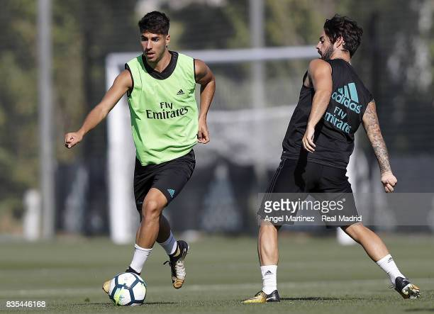 Marco Asensio and Isco of Real Madrid in action during a training session at Valdebebas training ground on August 19 2017 in Madrid Spain