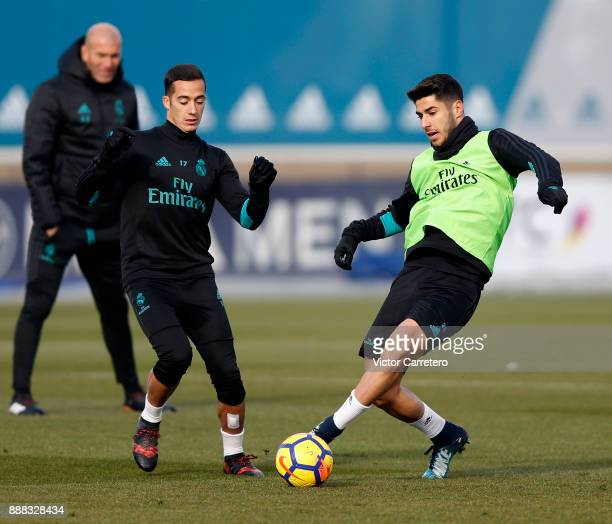 Marco Asensio and Lucas Vazquez of Real Madrid in action during a training session at Valdebebas training ground on December 8 2017 in Madrid Spain