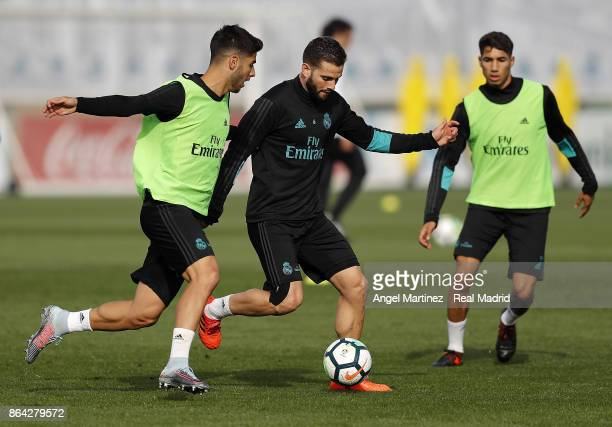 Marco Asensio Nacho Fernandez and Achraf Hakimi of Real Madrid in action during a training session at Valdebebas training ground on October 21 2017...
