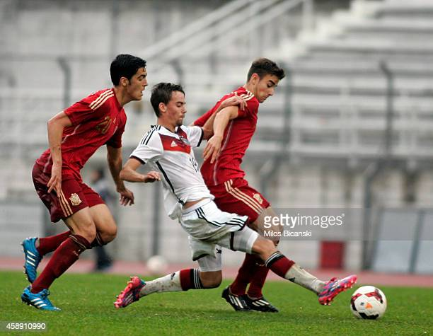 Marco Asensio of Germany competes with Amiri Nadiem and Mikel Merinero of Spain during the UEFA U19 friendly match between Spain and Germany at...