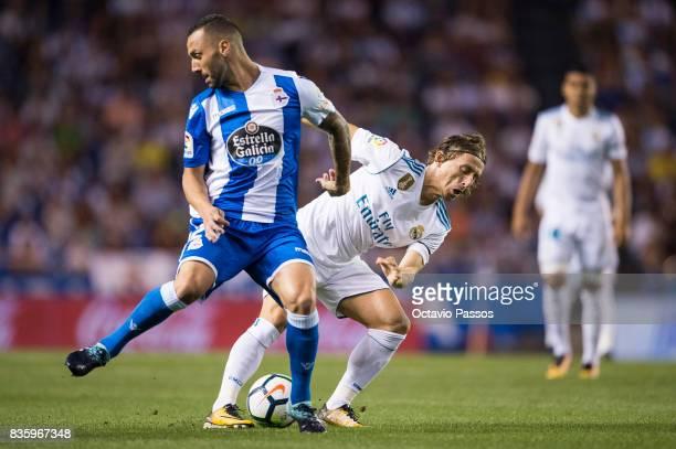 Marco Asensio of RC Deportivo La Coruna competes for the ball with Luka Modric of Real Madrid during the La Liga match between Deportivo La Coruna...