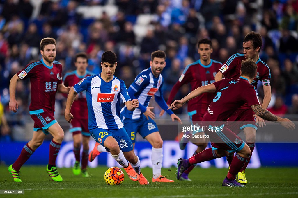 <a gi-track='captionPersonalityLinkClicked' href=/galleries/search?phrase=Marco+Asensio&family=editorial&specificpeople=13723927 ng-click='$event.stopPropagation()'>Marco Asensio</a> (2nd L) of RCD Espanyol conducts the ball during the La Liga match between RCD Espanyol and Real Sociedad de Futbol at Cornella-El Prat Stadium on February 8, 2016 in Barcelona, Spain.