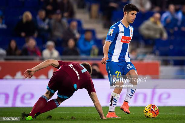 Marco Asensio of RCD Espanyol controls the ball next to Asier Illarramendi of Real Sociedad de Futbol during the La Liga match between RCD Espanyol...