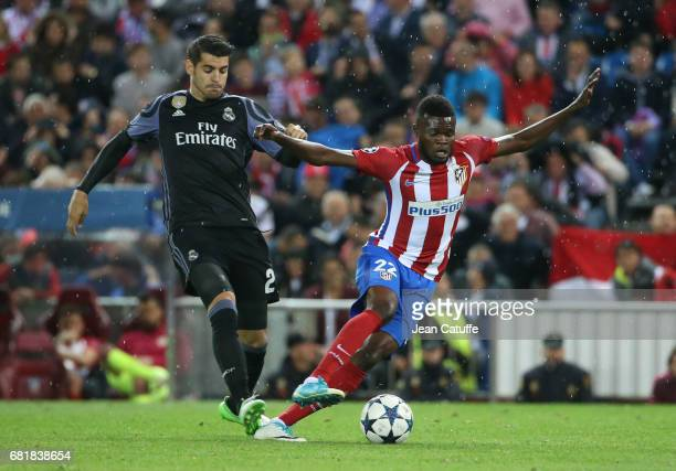 Marco Asensio of Real Madrid and Thomas Partey of Atletico Madrid during the UEFA Champions League Semi Final second leg match between Club Atletico...