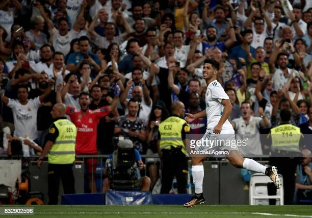 Marco Asensio of Real Madrid celebrates after scoring during the Spanish Super Cup return match between Real Madrid and Barcelona at Santiago...