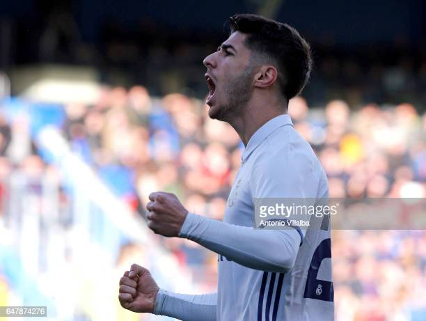 Marco Asensio of Real Madrid celebrates after scoring his team«s fouth goal during the La Liga match between SD Eibar and Real Madrid CF at Estadio...