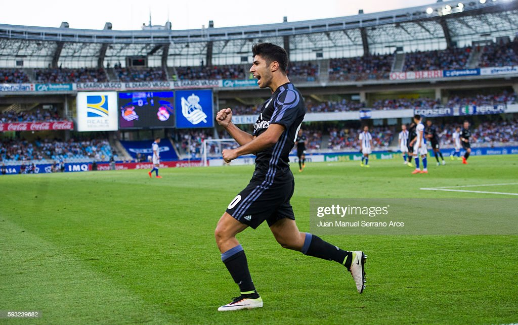 Marco Asensio of Real Madrid celebrates after scoring his team's second goal during the La Liga match between Real Sociedad de Futbol and Real Madrid...