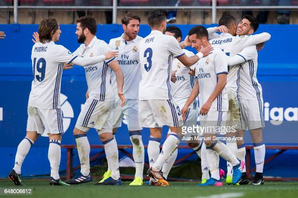 Marco Asensio of Real Madrid celebrates after scoring his team's fourth goal during the La Liga match between SD Eibar and Real Madrid at Ipurua...