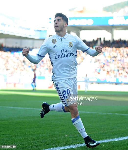 Marco Asensio of Real Madrid celebrates after scoring Real's 4th goal during the La Liga match between SD Eibar and Real Madrid CF at Estadio...