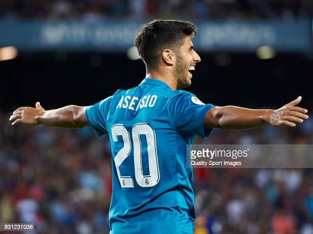 Marco Asensio of Real Madrid celebrates after scoring the third goal during the Supercopa de Espana Supercopa Final 1st Leg match between FC...