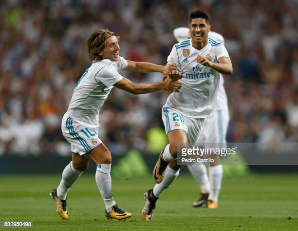 Marco Asensio of Real Madrid celebrates after scoring with his teammate Luka Modric during the Supercopa de Espana Final second leg match between...