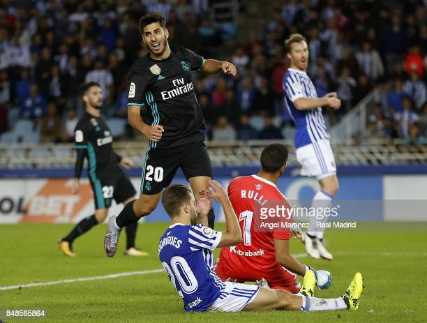 Marco Asensio of Real Madrid celebrates his team's firts goal during the La Liga match between Real Sociedad and Real Madrid CF at Anoeta Stadium on...