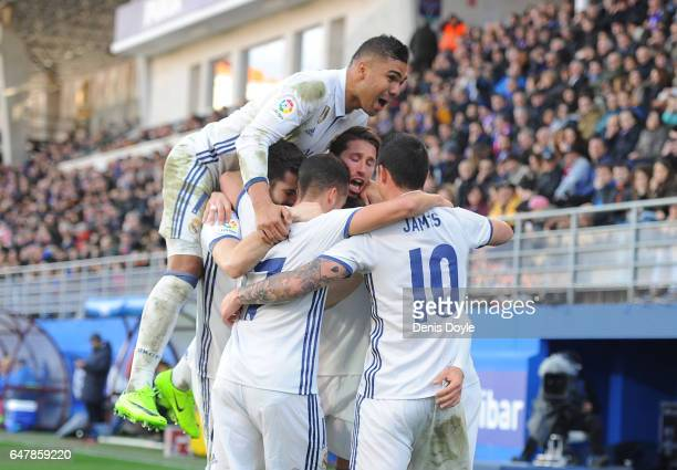 Marco Asensio of Real Madrid celebrates James Rodriguez Lucas Vazquez and Henrique Casemiro after scoring Real's 4th goal during the La Liga match...