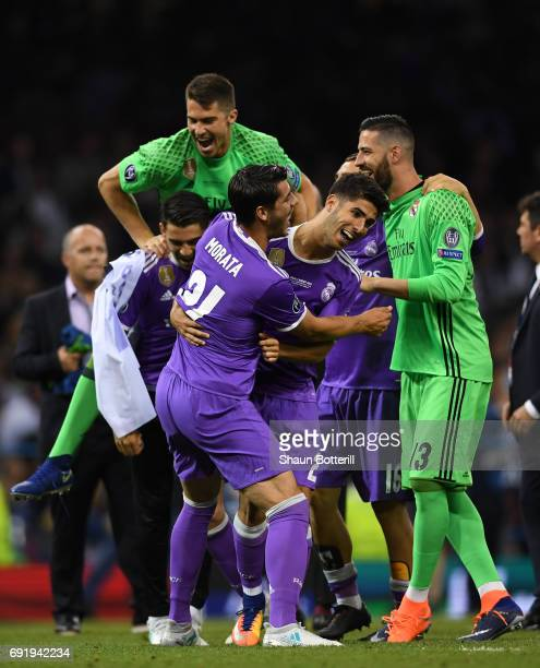 Marco Asensio of Real Madrid celebrates scoring his sides fourth goal with his Real Madrid team mates during the UEFA Champions League Final between...