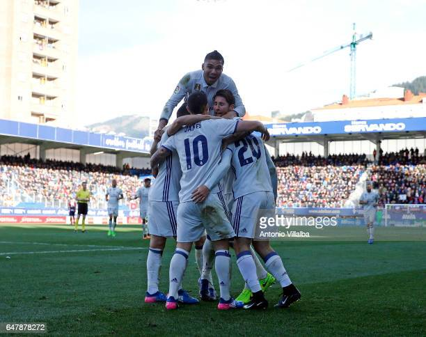 Marco Asensio of Real Madrid celebrates Whit teammates after scoring his team`s fourth goal during the La Liga match between SD Eibar and Real Madrid...