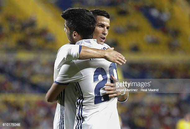 Marco Asensio of Real Madrid celebrates with Cristiano Ronaldo after scoring the opening goal during the La Liga match between UD Las Palmas and Real...