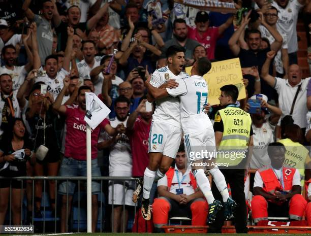 Marco Asensio of Real Madrid celebrates with his teammate Lucas Vazquez after scoring during the Spanish Super Cup return match between Real Madrid...