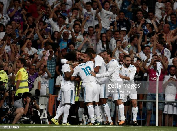 Marco Asensio of Real Madrid celebrates with his teammates after scoring during the Spanish Super Cup return match between Real Madrid and Barcelona...