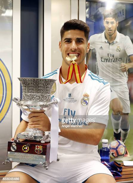 Marco Asensio of Real Madrid celebrates with the trophy after the Supercopa de Espana Final second leg match between Real Madrid and FC Barcelona at...