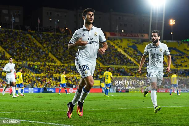 Marco Asensio of Real Madrid CF celebrates after scoring his team's first goal during the La Liga match between UD Las Palmas and Real Madrid CF on...