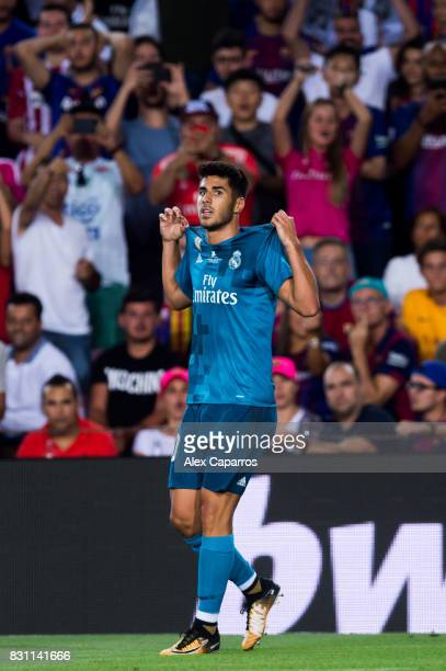 Marco Asensio of Real Madrid CF celebrates after scoring his team's third goal during the Supercopa de Espana Supercopa Final 1st Leg match between...