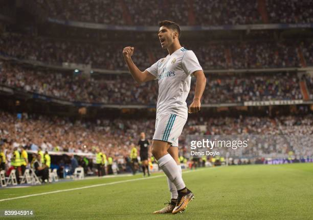 Marco Asensio of Real Madrid CF celebrates after scoring his team's 1st goal during the La Liga match between Real Madrid CF and Valencia CF at...