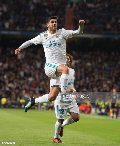 Marco Asensio of Real Madrid CF celebrates after scoring his team's 2nd goal during the La Liga match between Real Madrid and Las Palmas at Estadio...
