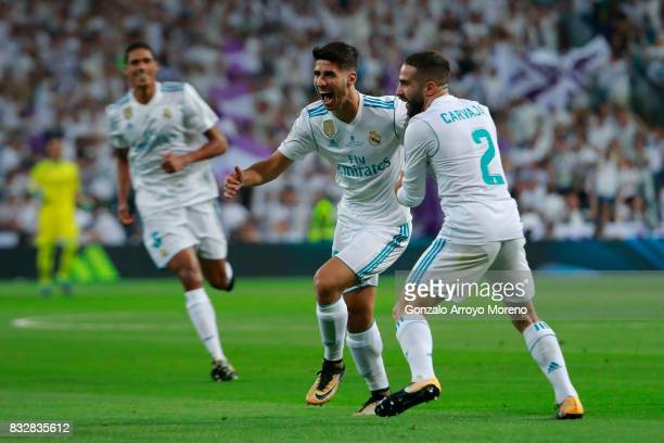 Marco Asensio of Real Madrid CF celebrates scoring their opening goal with teammate Daniel Carvajal during the Supercopa de Espana Final 2nd Leg...