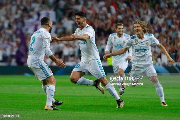 Marco Asensio of Real Madrid CF celebrates scoring their opening goal with teammate Daniel Carvajal and Luka Modric during the Supercopa de Espana...