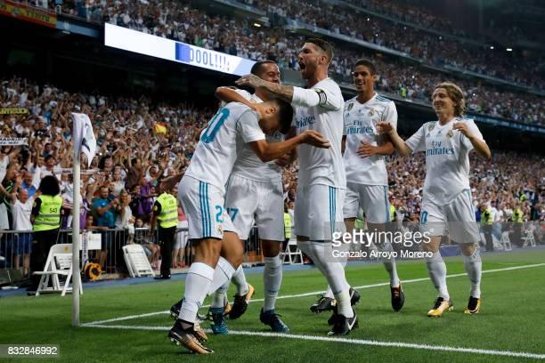 Marco Asensio of Real Madrid CF celebrates scoring their opening goal with teammates Lucas Vazquez Sergio Ramos Raphael Varane and Luka Modric during...
